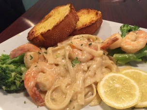 Shrimp, chicken and broccoli served with Alfredo sauce