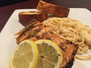 Grilled salmon served with Alfredo sauce